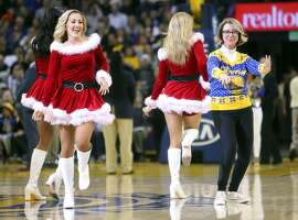 """Robin Schreiber of Redwood City, aka """"Dancing Mom,"""" dances with the Golden State Warriors' dance team during 1st quarter time out of Warriors' 104-74 win over Utah Jazz during NBA game at Oracle Arena in Oakland, Calif., on Tuesday, December 20, 2016."""