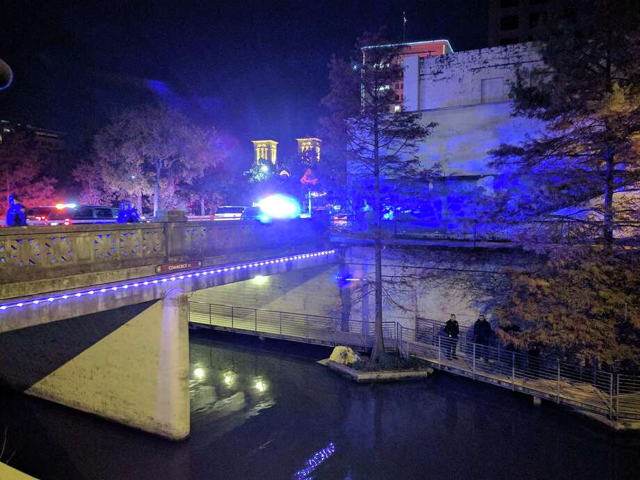 A body was found floating in the San Antonio River at about 9:30 p.m. Tuesday in the 100 block of Commerce Street. Photo: Jacob Beltran /San Antonio Express-News