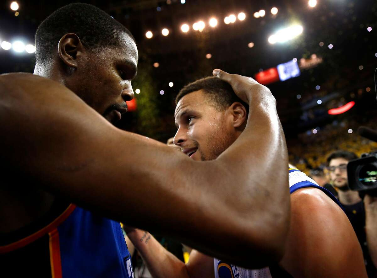 Golden State Warriors' Stephen Curry and Oklahoma City Thunder's Kevin Durant meet after Warriors' 96-88 win in Game 7 of NBA Playoffs' Western Conference finals at Oracle Arena in Oakland, Calif., on Monday, May 30, 2016.