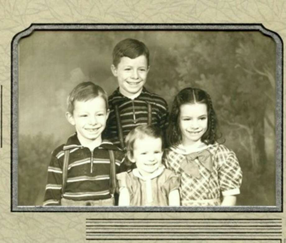 Junior Crall is in the back and in the front are Dale, Nancy and Dolly.  Years ago, their mother Dorothy wrote her memories of her marriage and her children with each family member writing his or her memories of the family as they grew up. That family history is a treasure trove today.