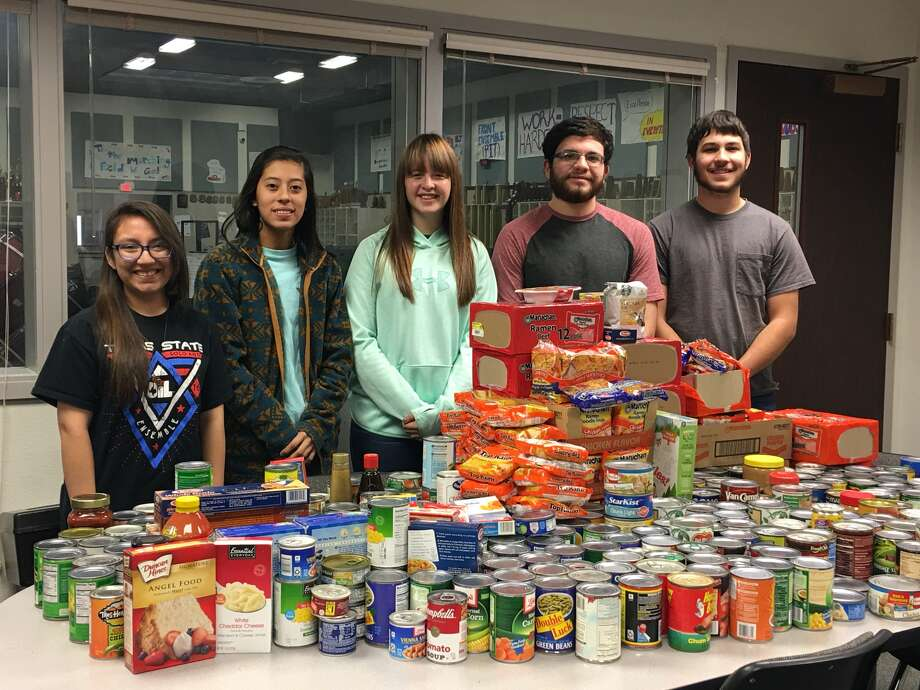 The Plainview High School Band recently hosted a canned food drive as a community service project. More than 600 food items were collected and donated to The Salvation Army. Shown with a portion of the food collection are drum majors Samantha Hernandez, LeeAnn Grimaldo, Kamren Smock, John David Andrade and Colton Langston.