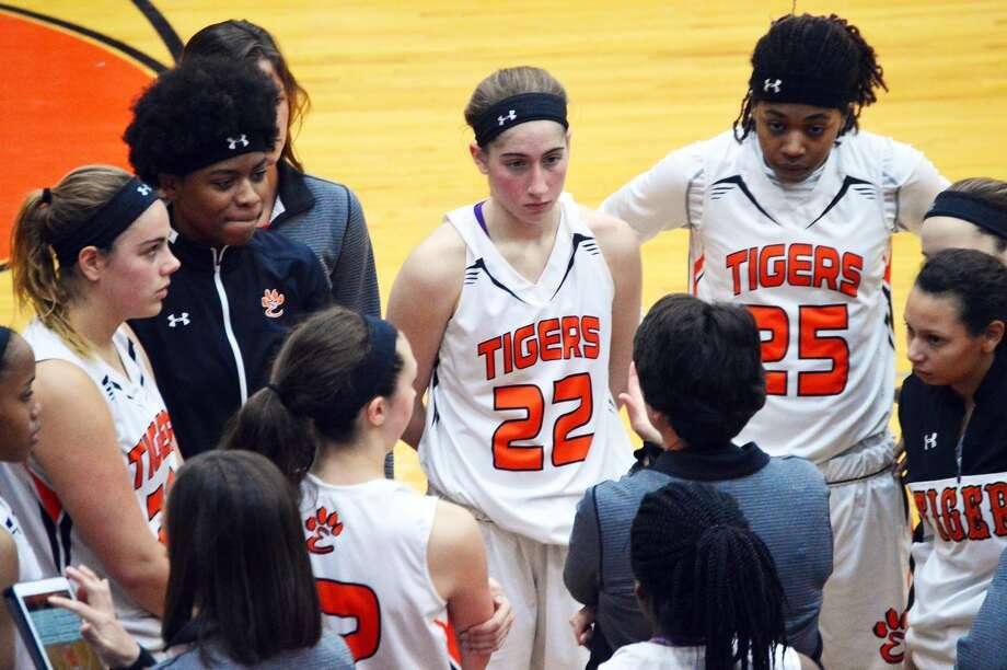 Edwardsville girls' basketball players listen to coach Lori Blade before the start of a regular season game against Normal Community.