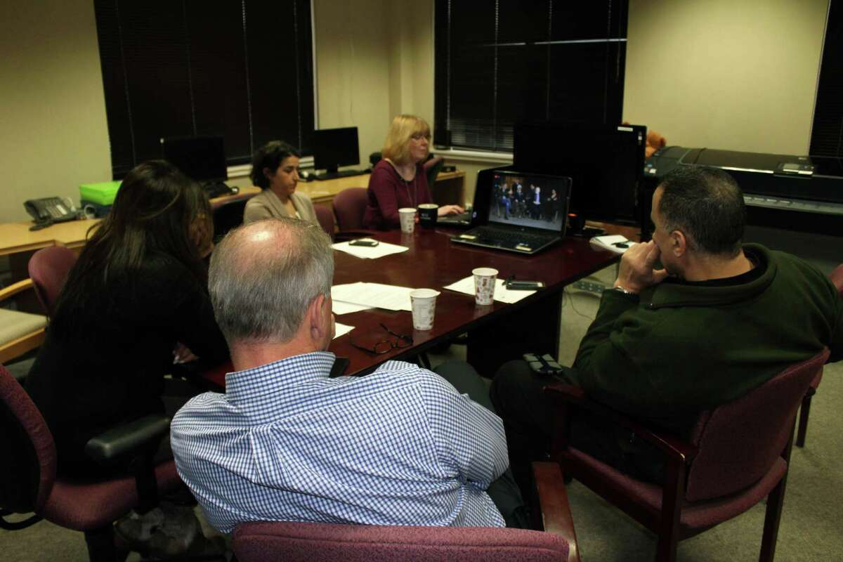 A group watch the Facebook Live event hosted by Jon Stewart raising awareness for the 9/11 Health and Compensation Reauthorization Act on Dec. 18, 2016 at the New Canaan, Conn. office of Voices for September 11th.