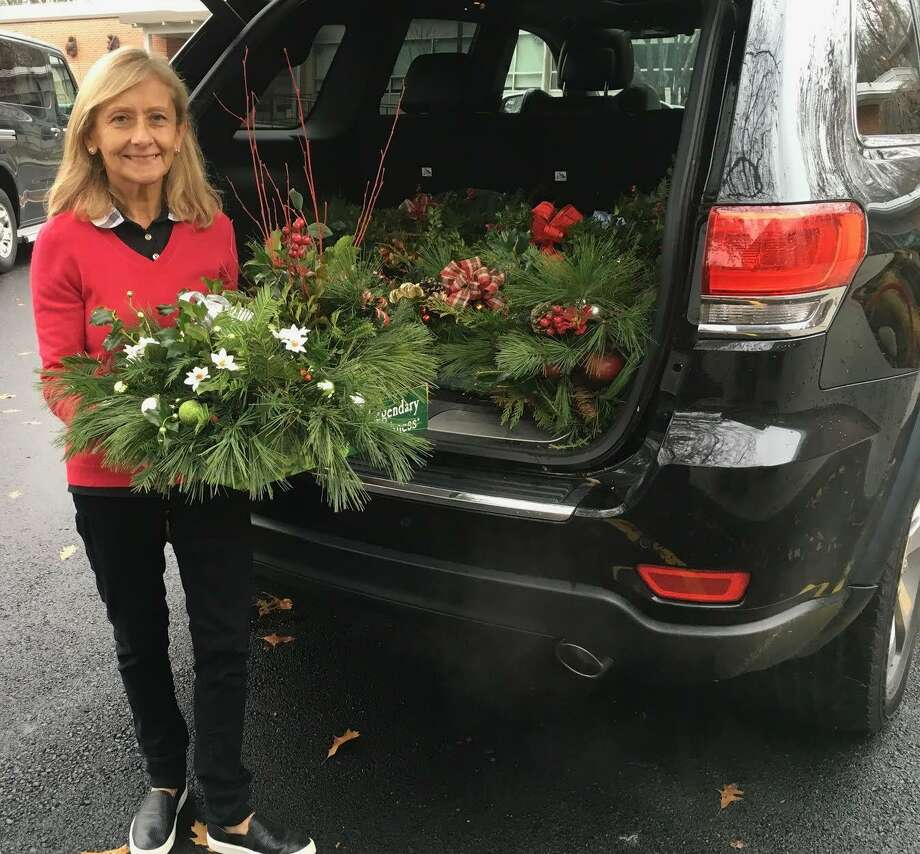 Wilton Garden Club member Melina Cortes delivers holiday baskets to Social Services at Comstock Community Center. Photo: Contributed Photo