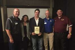 The children of late Jay baseball coach Johnny Campos accept a plaque recognizing his induction into the San Antonio Area Baseball Coaches Association Hall of Honor. Pictured are O'Connor coach David Collenback (from left), daughter Payten Campos, son Brandon Campos, Alamo Heights coach Jason Thompson and Harlandale coach Eric Forestier.