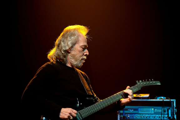 "ALBUQUERQUE, NM - DECEMBER 31: Canned Heat guitarist Harvey ""The Snake"" Mandel performs with The Heroes of Woodstock at Route 66 Casino's Legends Theater on December 31, 2009 in Albuquerque, New Mexico. Harvey joined Canned Heat in 1969 and remained with the group for over a year in their heyday.  (Photo by Steve Snowden/Getty Images)"