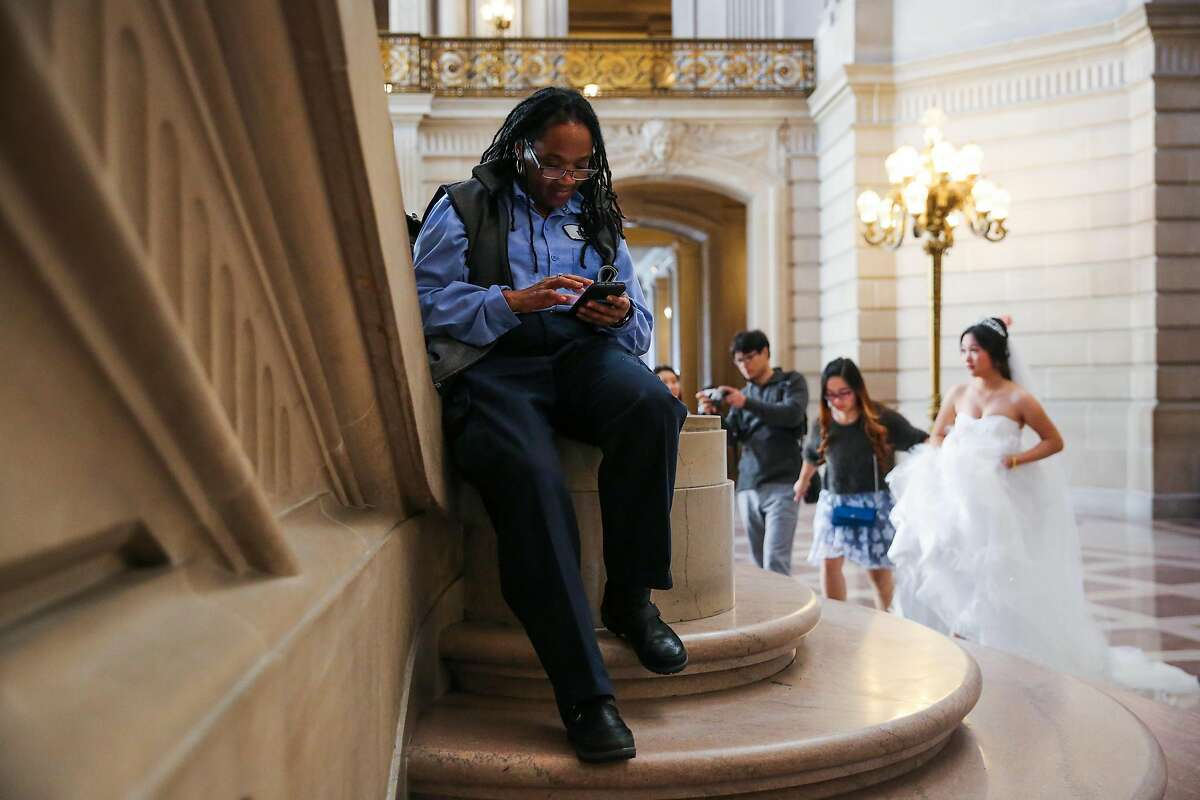 Claudine Bingham, a longtime maintenance worker at City Hall, checks her phone while taking a work break, at City Hall, in San Francisco, California, on Monday, Nov. 28, 2016. This past summer, via facebook, Claudine found her sister Barbara Barnette and they reunited for the first time in person in 45 years.
