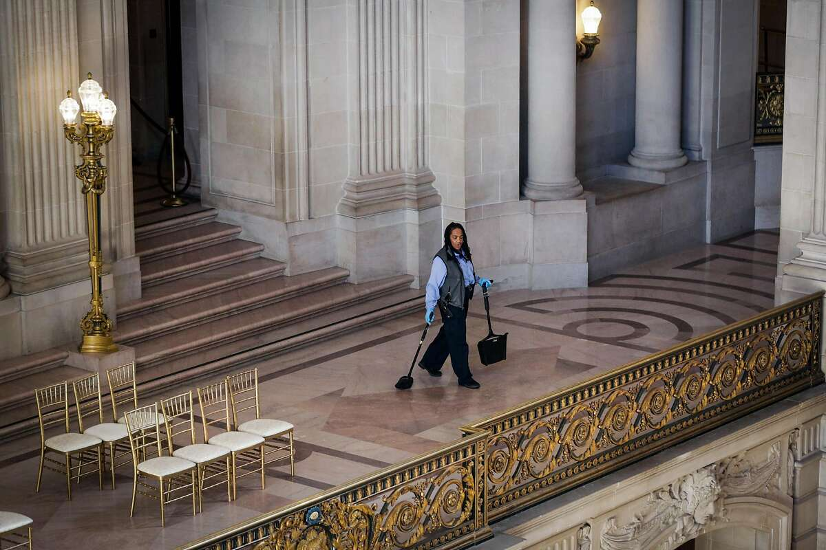 Claudine Bingham, a longtime maintenance worker at City Hall, sweeps the floor of a balcony at City Hall, in San Francisco, California, on Monday, Nov. 28, 2016. This past summer, via facebook, Claudine found her sister Barbara Barnette and they reunited for the first time in person in 45 years.
