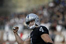 The Raiders Derek Carr (4) signaled the crowd after a touchdown in the second half/ The Oakland Raiders defeated the Buffalo Bills 38-24 at the Coliseum Sunday December 4, 2016 to run their record to 10-2.
