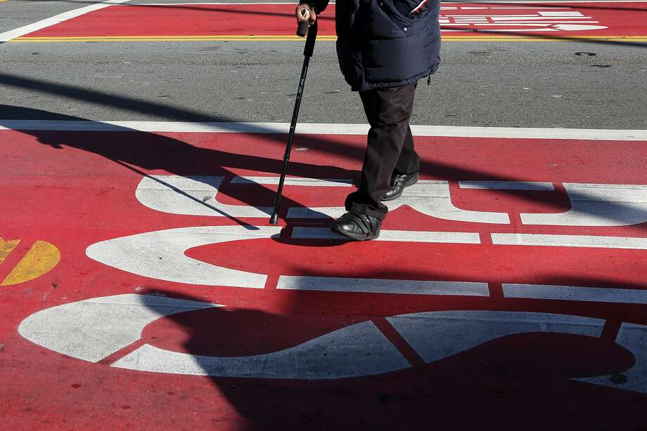 The red transit-only lanes seen at 16th and Mission St on Friday, December 16 2016 in San Francisco, Calif. Photo: Amy Osborne, Special To The Chronicle