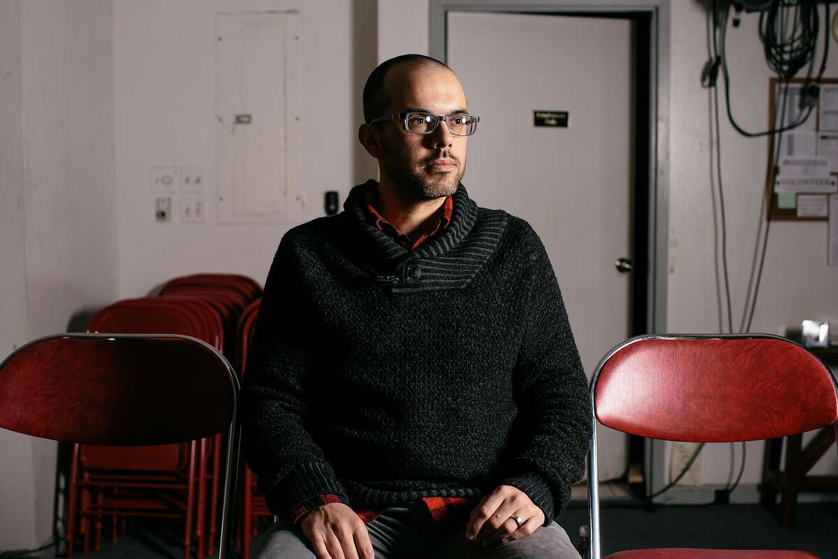 SF Neo Futurists artistic director Adam Smith sits in the SAFEHouse Arts venue on Market Street in San Francisco, California, on December 20, 2016.