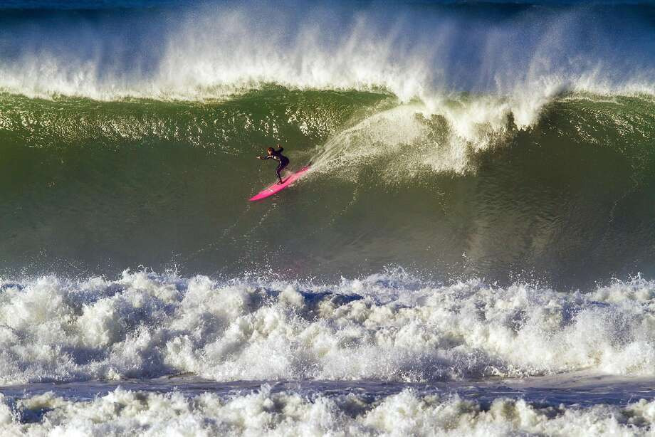 In this 2015 file photo, Bianca Valenti drops into a big wave at Ocean Beach. The Bay Area coast can expect towering waves this week as a major storm arrives. Photo: Bruce W. Topp/NorcalSurfPhotos