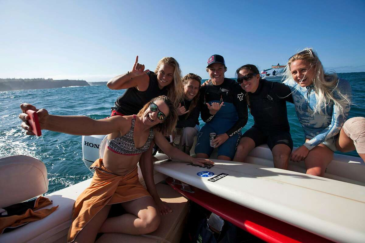 Bianca Valenti takes a group selfie with fellow surfers (from left) Felicity Palmateer, Tammy Lee Smith, Paige Alms, Andrea Mollera and Laura Enever during the inaugural World Surf League Pe'ahi Women's Challenge in Maui, Hawaii on November 11, 2016. San Francisco Bay area local surfer Bianca Valenti placed 5th overall and Paige Alms won the event. Photo by Sachi Cunningham