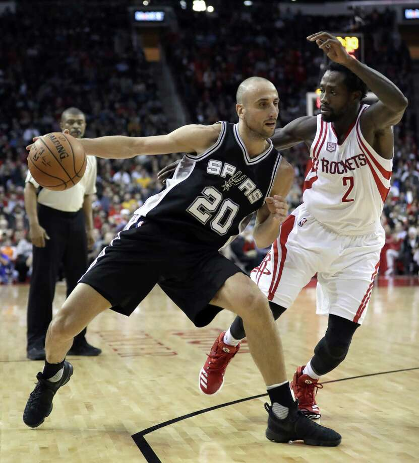 San Antonio Spurs' Manu Ginobili (20) drives toward the basket as Houston Rockets' Patrick Beverley (2) defends during the second half of an NBA basketball game Tuesday, Dec. 20, 2016, in Houston. The Spurs won 102-100. (AP Photo/David J. Phillip) Photo: David J. Phillip, STF / Associated Press / Copyright 2016 The Associated Press. All rights reserved.
