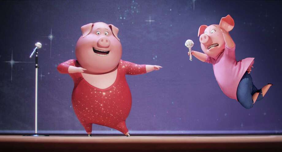 """This image released by Universal Pictures shows Gunter, voiced by Nick Kroll, left, and Rosita, voiced by Reese Witherspoon, in a scene from, """"Sing.""""  (Illumination Entertainment/Universal Pictures via AP) ORG XMIT: NYET271 / Copyright: © 2016 Universal Studios. ALL RIGHTS RESERVED."""