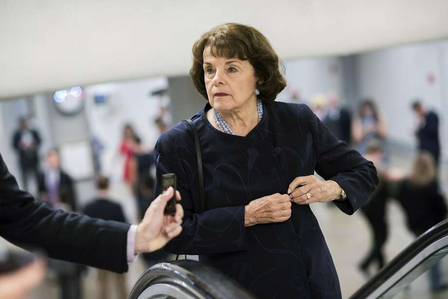 Sen. Dianne Feinstein, D-Calif., talks with a reporter in Senate subway before the Senate Policy luncheons in the Capitol, September 13, 2016. Photo: Tom Williams, CQ-Roll Call,Inc.