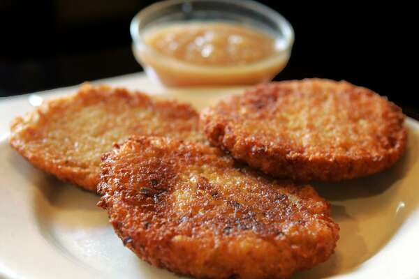 Latkes with applesauce on the side.