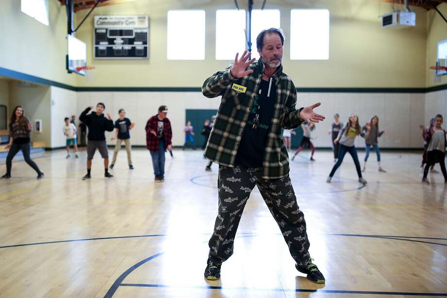 Buck Chavez, a PE teacher at San Geronimo Valley School, plays music and dances along with his students during a PE class on December 14, 2016 in San Geronimo, Calif. Photo: Amy Osborne, Special To The Chronicle