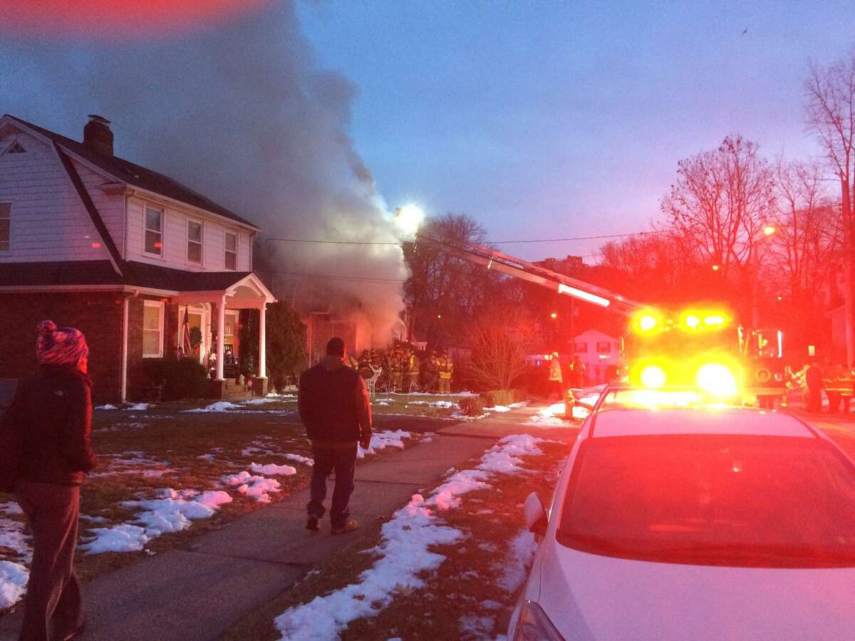 Stamford firefighters responding to a basement fire at 26 Underhill Street late in the afternoon on Dec. 21, 2016.