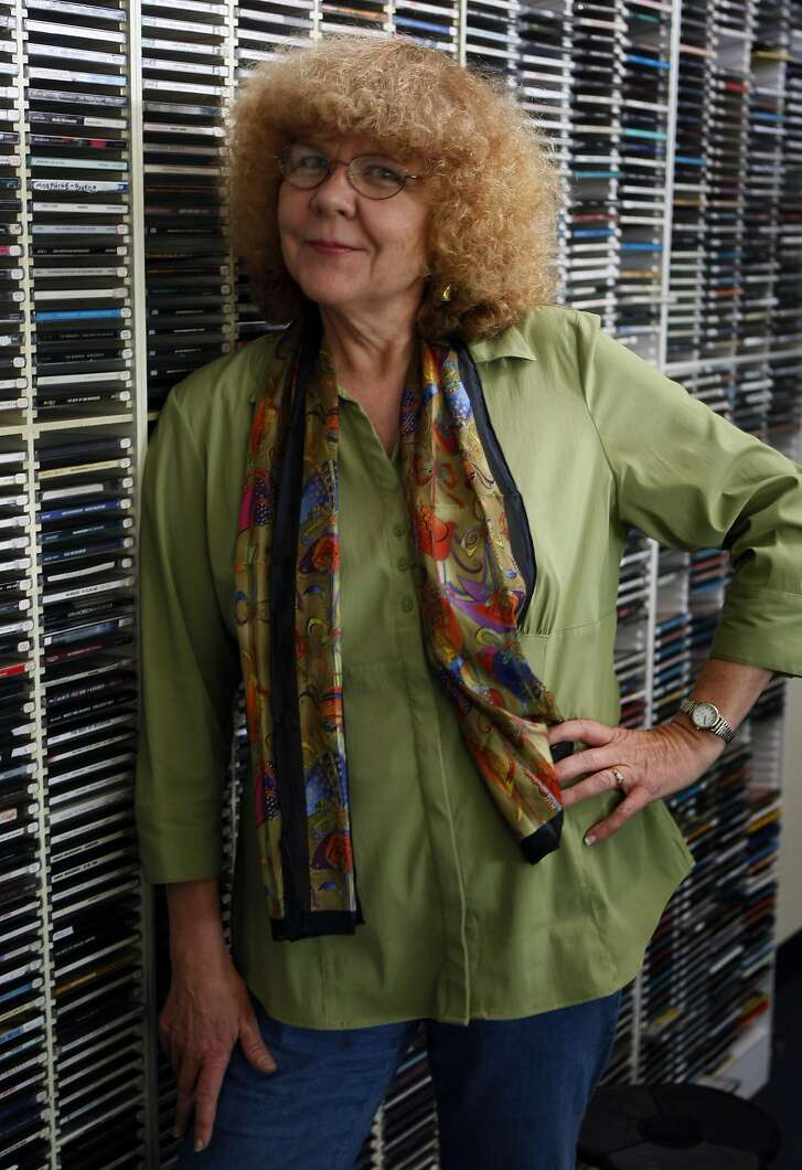 KFOG radio personality Rosalie Howarth stands in front of thousands of CD's in the On Air Studio in San Francisco Friday July 10, 2009