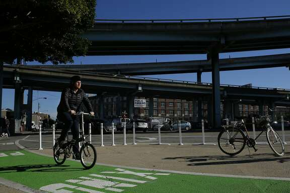 A bicyclist rides on new infrastructure at 9th Street and Division Street on Wednesday, Dec. 21, 2016 in San Francisco, Calif. As part of the city's Vision Zero program, San Francisco officials announced the completion of its first protected intersection, which provides protected bike lanes and pedestrian crossings and waiting areas at 9th and Division streets.