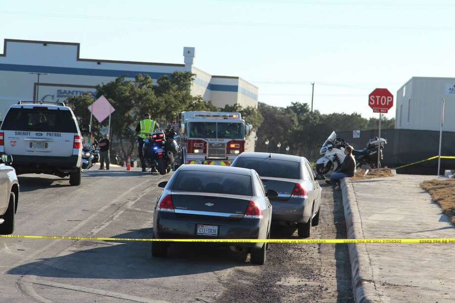 Three people died Dec. 21, 2016, in a two-vehicle crash outside the Santikos Casa Blanca movie theater on the far West Side. Photo: Tyler White, San Antonio Express-News / San Antonio Express-News
