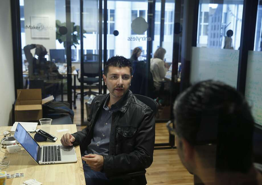 Mike Galarza, CEO of Entryless, works out of his start-up's workspace with Bobby Khamis (right) in San Francisco. Photo: Paul Chinn, The Chronicle
