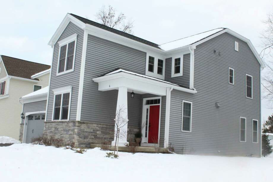 According to Saratoga County records, Navnoor Kang purchased this home at 6 Maria Lane in Saratoga Springs for $412,660 in 2015. At the time, federal prosecutors said Kang, then a top manager in the state pension fund was accepting bribes from two broker-dealers in return for steering state investment funds to their firms. (Wendy Liberatore / Times Union)