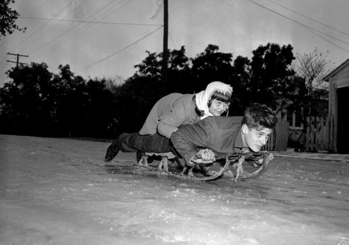 Kay Hornaday and Ray Conder ride a snow sled down icy hill in Alamo Heights, December 31, 1946 (San Antonio Light Collection, MS 359: L-3333-L) Courtesy