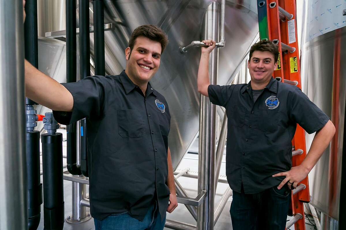 Owner Chris Jackson with brewmaster Andy Hooper at the Seismic Brewery in Santa Rosa, Calif. are seen on December 1st, 2016.