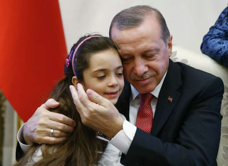 Bana al-Abed, with Turkey's President Recep Tayyip Erdogan, had become an icon representing Syrian children living through the nightmare of seige. Photo: STF, POOL / Presidency Press Service