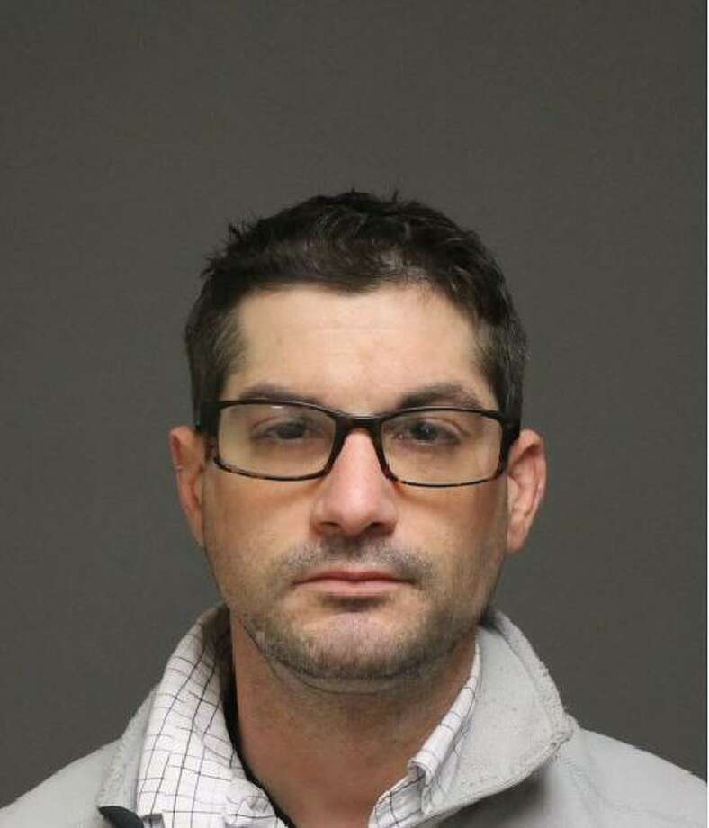 Christopher Bartmess, 35, of Fairfield, was charged with operating under the influence, narcotics possession and use and possession of drug paraphernalia in Fairfield, Conn. on Dec. 14, 2016. Photo: Fairfield Police / Contributed Photo / Fairfield Citizen