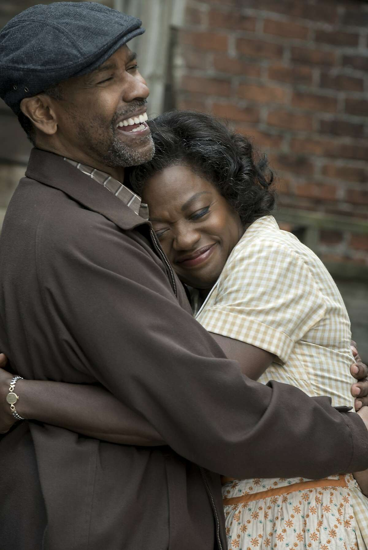 """This image released by Paramount Pictures shows Denzel Washington, left, and Viola Davis in a scene from """"Fences."""" (David Lee/Paramount Pictures via AP)"""
