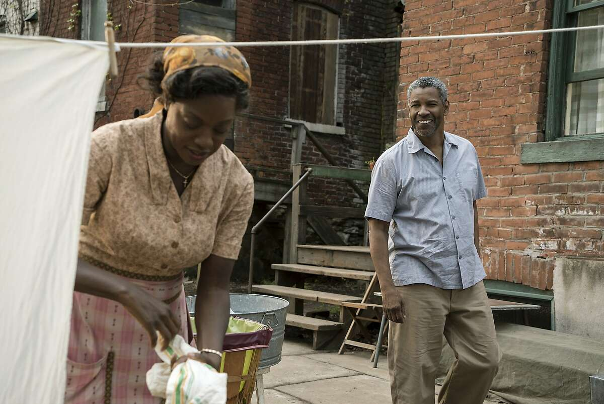 """This image released by Paramount Pictures shows Denzel Washington, right, and Viola Davis in a scene from """"Fences,"""" directed by Washington. (David Lee/Paramount Pictures via AP)"""