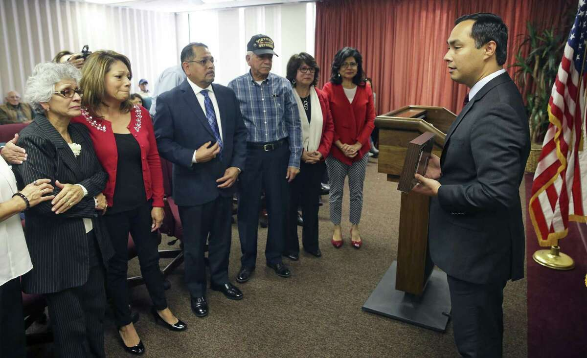 U.S. Congressman Joaquin Castro awards five military service medals to the family of Anselmo Castro, a WWII vetaran, on December 21, 2016.