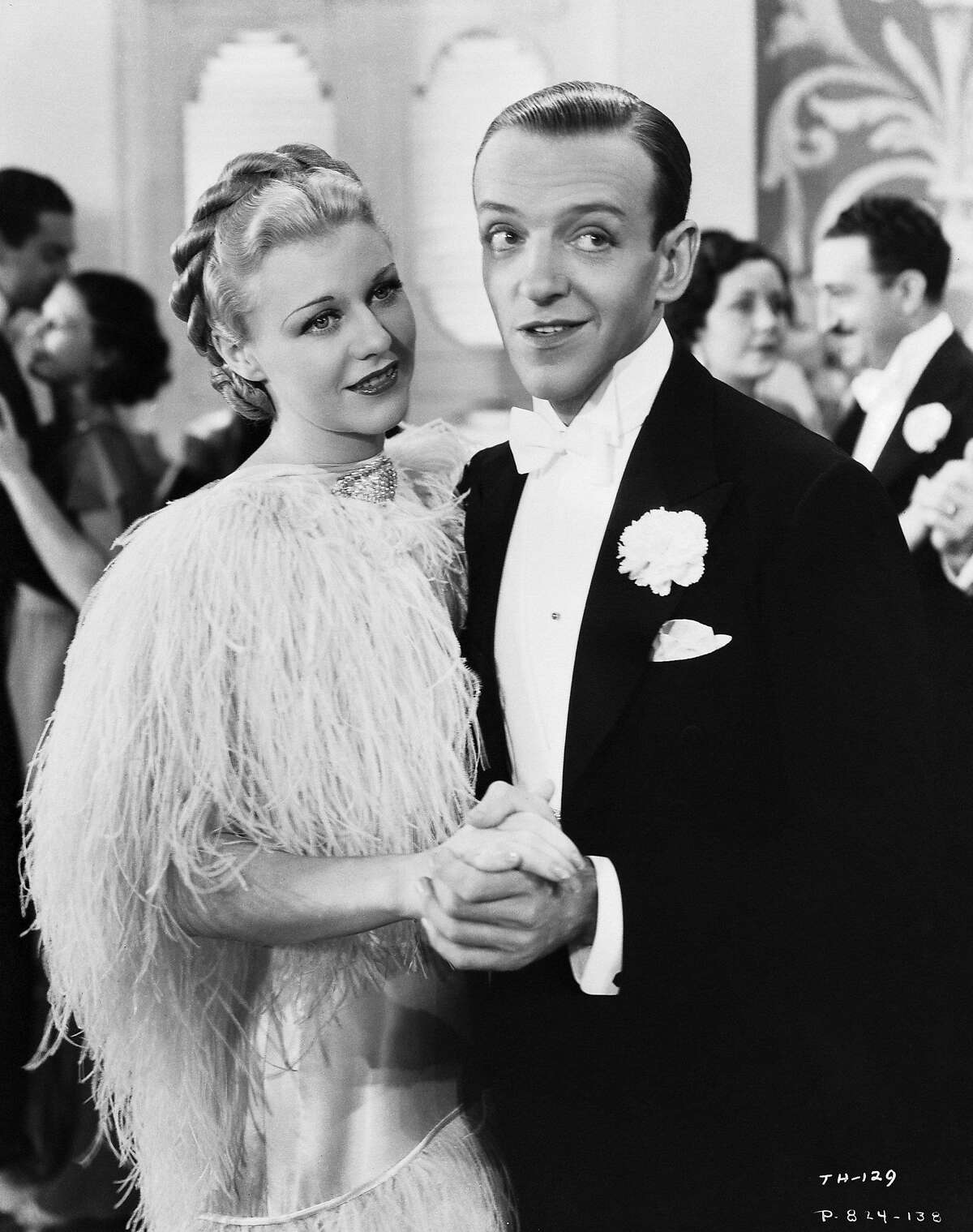 Fred Astaire (1899 - 1987) and Ginger Rogers (1911 - 1995) in a scene from the comedy musical 'Top Hat', directed by Mark Sandrich, 1935. (Photo via John Kobal Foundation/Hulton Archive/Getty Images)