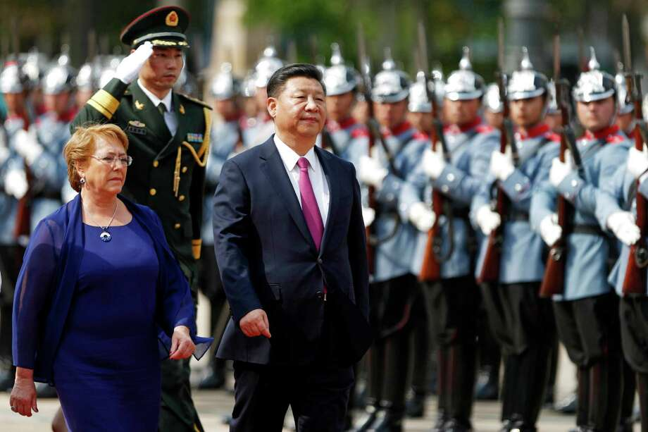 Chile's President Michelle Bachelet, left, accompanies China's President Xi Jinping as he arrives to La Moneda presidential palace in Santiago, Chile, Tuesday, Nov. 22, 2016. Jinping is in Chile after attending the APEC summit in Peru. (AP Photo/Luis Hidalgo) Photo: Luis Hidalgo, STR / AP