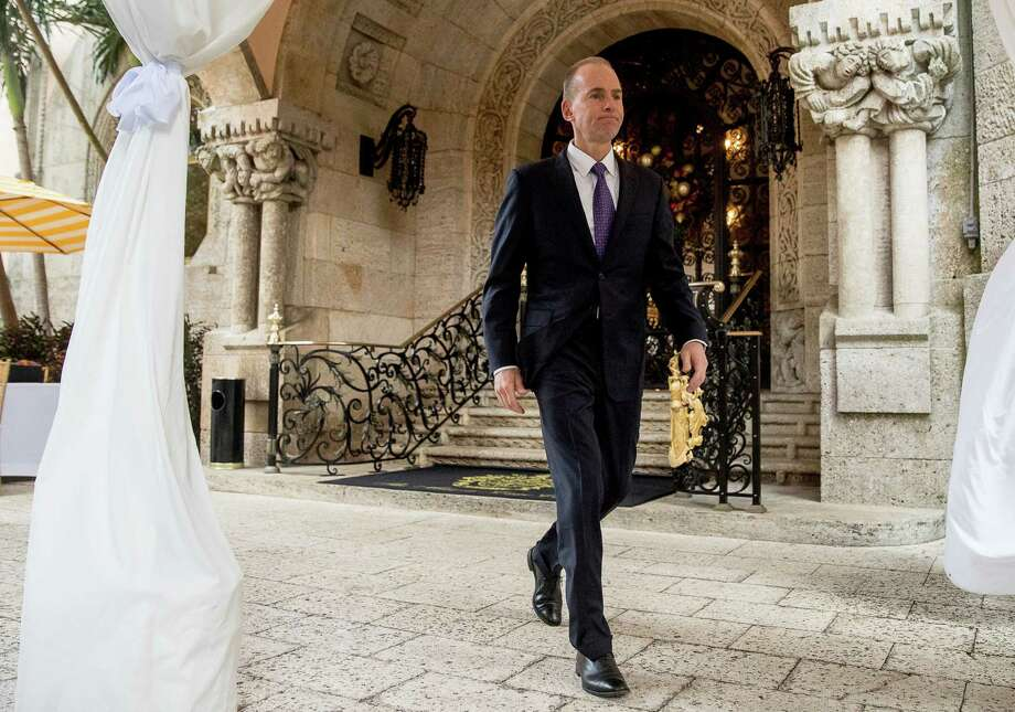 Boeing CEO Dennis Muilenburg departs Wednesday after meeting with President-elect Donald Trump at Mar-a-Lago in Palm Beach, Fla. Photo: Andrew Harnik, STF / Copyright 2016 The Associated Press. All rights reserved.