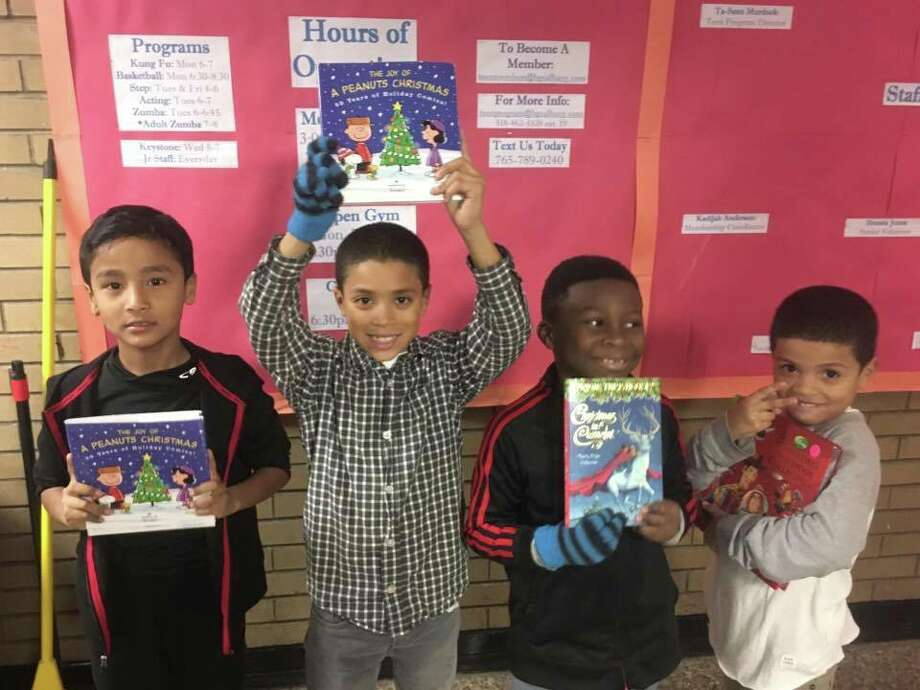 Grassroot Givers and the Boys and Girls Club of Albany celebrate providing over 100,000 books to the Capital Region. (Submitted by Adam Wage)