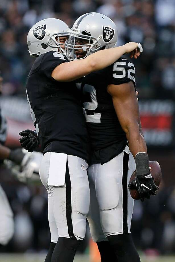 Khalil Mack #52 of the Oakland Raiders celebrates with Derek Carr #4 after a fumble recovery against the Buffalo Bills during their NFL game at Oakland Alameda Coliseum on December 4, 2016 in Oakland, California.  (Photo by Brian Bahr/Getty Images) Photo: Brian Bahr / Getty Images 2016