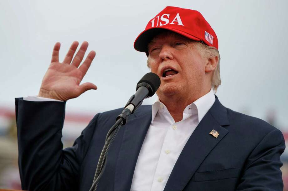 FILE - In this Saturday, Dec. 17, 2016, file photo, President-elect Donald Trump speaks during a rally at Ladd-Peebles Stadium in Mobile, Ala. Trump is poised to meet with his incoming national security adviser on Wednesday, Dec. 20, in the aftermath of a rattling day of violence around the world. (AP Photo/Evan Vucci, File) Photo: Evan Vucci, STF / Copyright 2016 The Associated Press. All rights reserved.