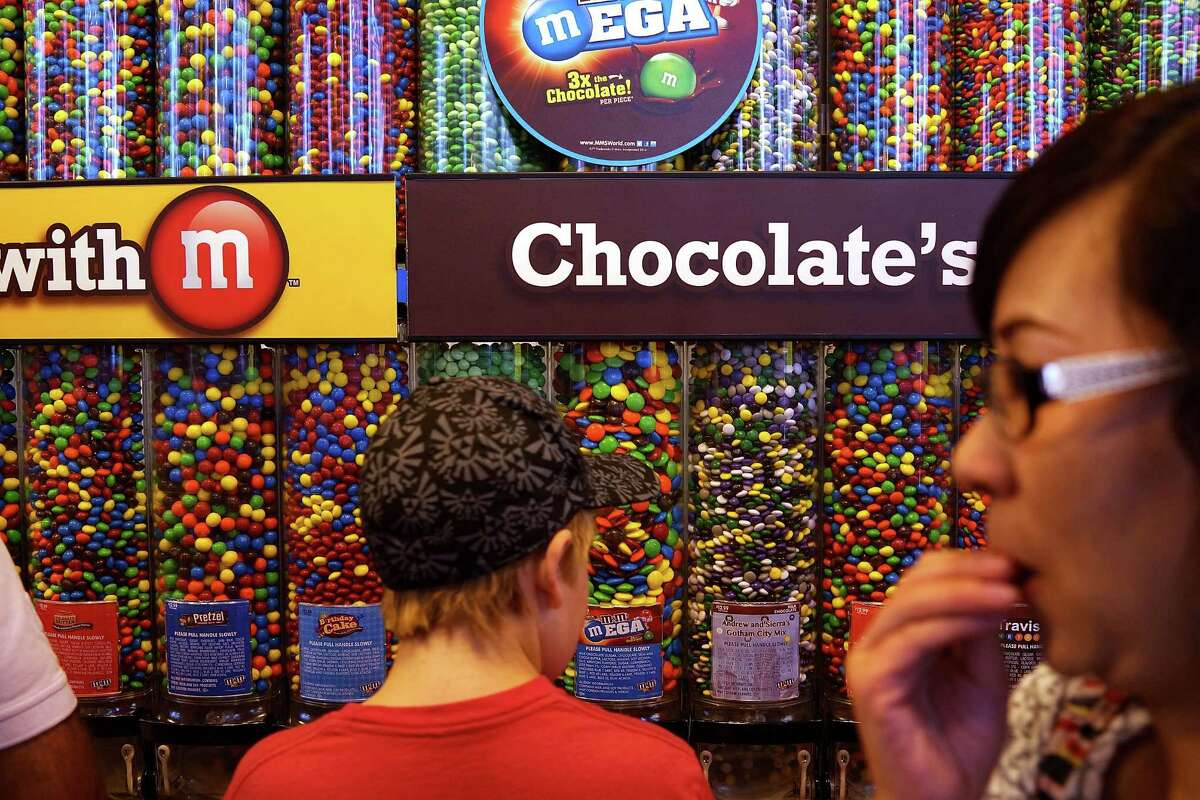 NEW YORK, NY - JULY 24: People visit the M&M store in Times Square on July 24, 2014 in New York City. With the increase in cocoa prices, Mars Chocolate North America, the maker of Snickers and M&M's, announced an average price increase of 7 percent this week for their chocolate products. (Photo by Spencer Platt/Getty Images) ORG XMIT: 503249155