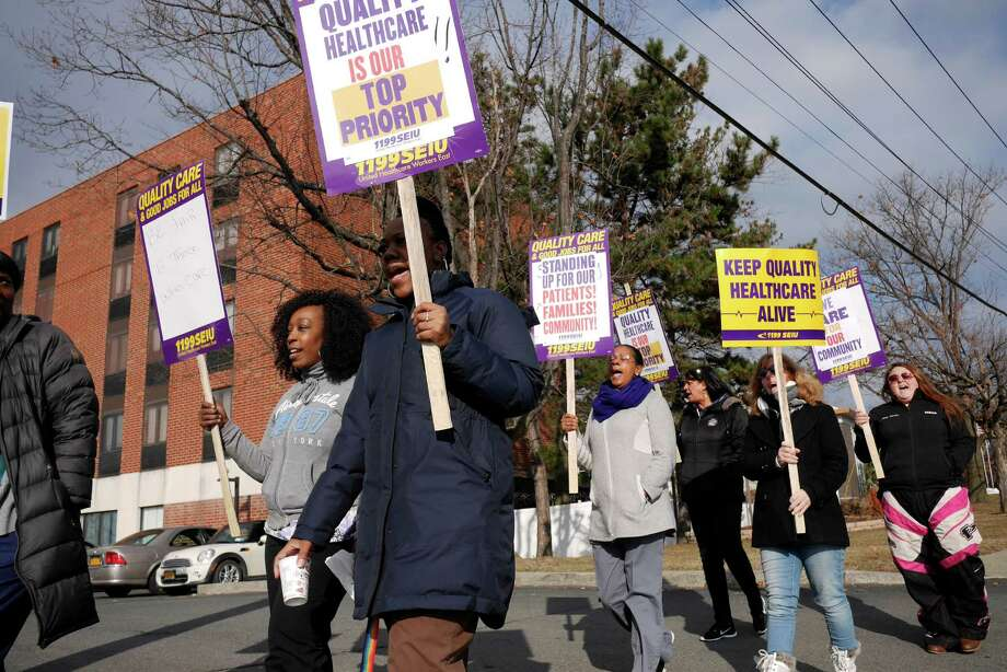 Members of 1199 SEIU, who are also employees at the Hudson Park Rehab and Nursing Center take part in an informational picket outside the center on Wednesday, Dec. 21, 2016, in Albany, N.Y.  Workers have been without a contract since April 2016.    (Paul Buckowski / Times Union) Photo: PAUL BUCKOWSKI / 20039213A