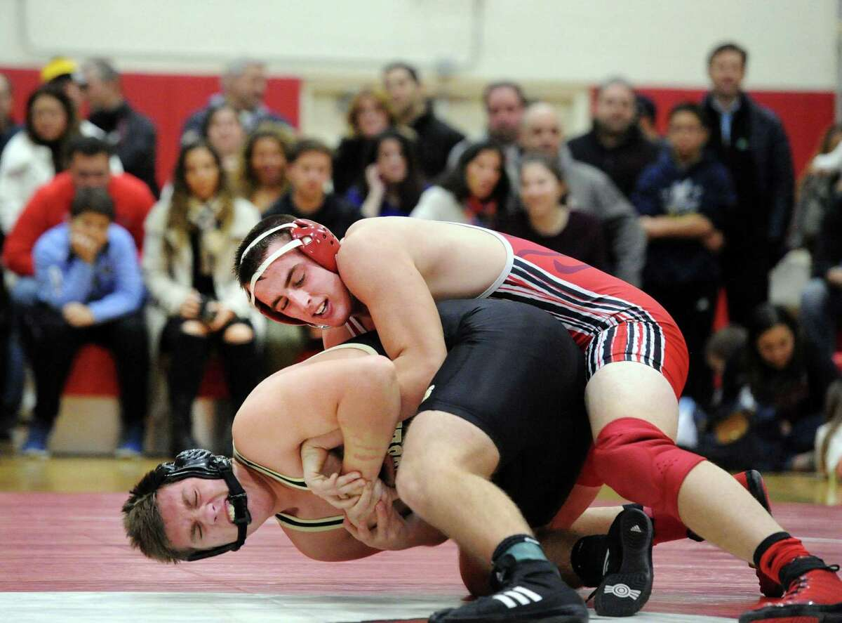 Greenwich's Peyton Larkin, top, goes against Trumbull's Joe Palmieri during their 195-pound match Wednesday at Greenwich High School. Larkin won the match with a 7-3 decision.