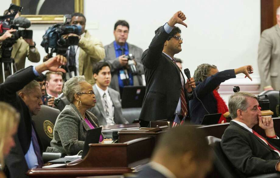 Democratic senators, including Jay J. Chaudhuri, center, oppose tabling an amendment to the repeal measure during the North Carolina General Assembly's special session on Wednesday.  Photo: Travis Long, MBR / Raleigh News & Observer