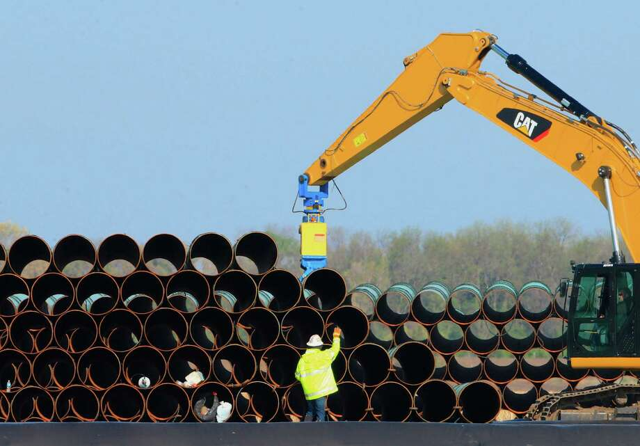 FILE - In this May 9, 2015 file photo, pipes for the proposed Dakota Access oil pipeline that will stretch from the Bakken oil fields in North Dakota to Illinois are stacked at a staging area in Worthing, S.D. Construction on the pipeline is now underway in North Dakota, South Dakota and Illinois, three of the four states that will carry the oil from western North Dakota. The pipeline also will cross Iowa, but regulators there have declined to act quickly on a request to allow Texas-based Energy Transfer Partners to begin construction in that state. (AP Photo/Nati Harnik, File) Photo: Nati Harnik, STF / Copyright 2016 The Associated Press. All rights reserved. This material may not be published, broadcast, rewritten or redistribu