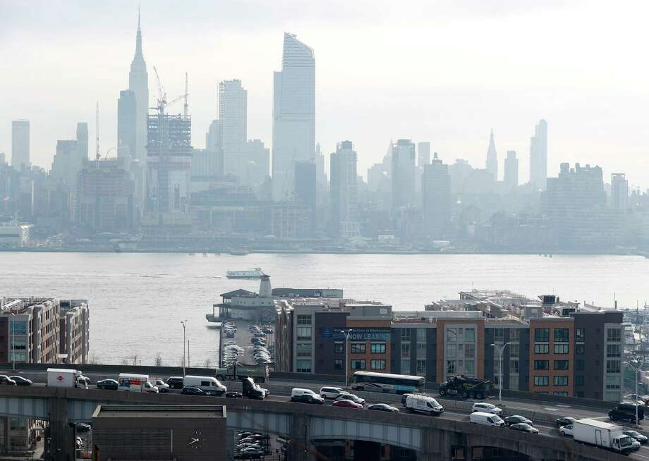 Traffic flow on the Lincoln Tunnel helix is seen with the New York City skyline from Weehawken, N.J., Wednesday, Dec. 21, 2016. The New York City Police department is collecting information voluntarily supplied by trucking and truck rental companies regarding the movement of goods in and out of the city. (AP Photo/Julio Cortez) ORG XMIT: NJJC201 Photo: Julio Cortez / Copyright 2016 The Associated Press. All rights reserved.