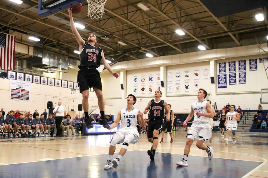 Chase Belden puts up a layup during the Warriors victory over Pomperaug in Wilton, Conn. on Wednesday, December 21, 2016. Photo: Chris Palermo / For Hearst Connecticut Media / Norwalk Hour Freelance