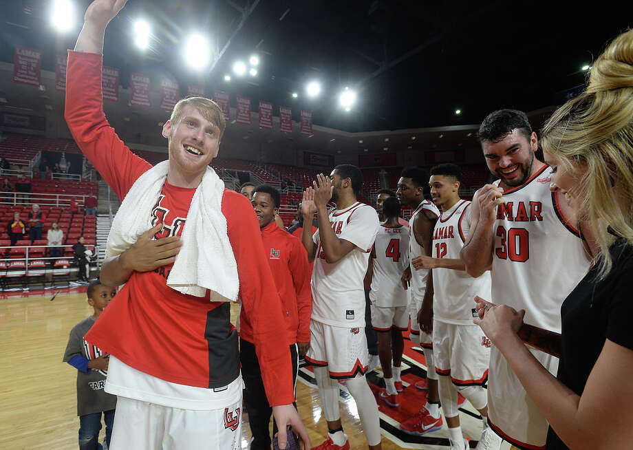 Lamar University basketball player Colton Weisbrod surprises his girlfriend Allison Jacks with a marriage proposal on the court following Wednesday night's game against Arlington Baptist at the Montagne Center. Photo taken Wednesday, December 21, 2016 Kim Brent/The Enterprise Photo: Kim Brent / Beaumont Enterprise
