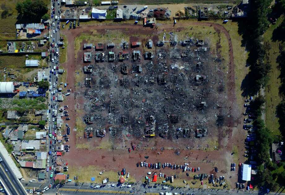 A fireworks market lays in ruins one day after an explosion at the San Pablito Market in Tultepec on the outskirts of Mexico City, Wednesday, Dec. 21, 2016. The market was especially well stocked for the holidays and bustling with hundreds of shoppers when a powerful chain-reaction explosion ripped through its stalls Tuesday, killing and injuring dozens. (AP Photo/Christian Palma) ORG XMIT: MXEV101 Photo: Christian Palma / Copyright 2016 The Associated Press. All rights reserved.